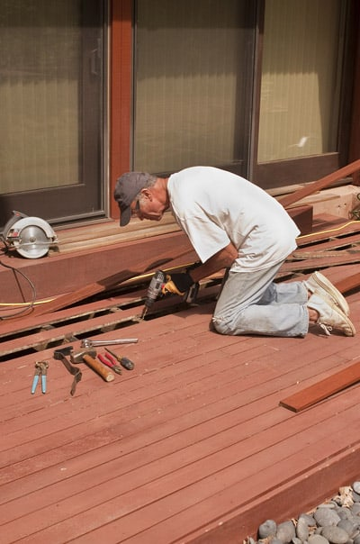 Gold Coast Deck Repair - Handyman repairing a deck in Palm Beach, Queensland