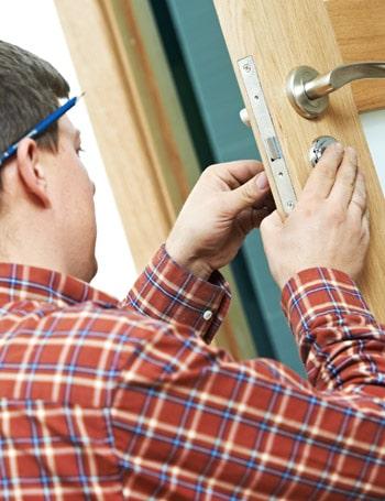 Gold Coast Door Repair Services - Handyman fixing a stuck door lock in Broadbeach Queensland