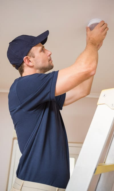 Smoke detector testing and installation in an apartment on the Gold Coast, Queensland
